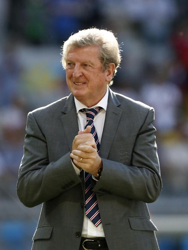 England's manager Roy Hodgson rubs his nada together after the group D World Cup soccer match between Costa Rica and England at the Mineirao Stadium in Belo Horizonte, Brazil, Tuesday, June 24, 2014. The match ended in a 0-0 draw. (AP Photo/Jon Super)