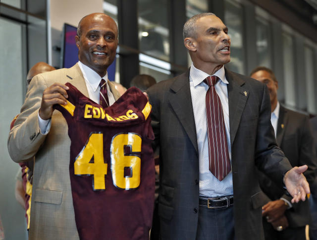 Newly appointed Arizona State University head coach Herman Edwards (R) with Athletic Director Ray Anderson. (AP Photo/Matt York)