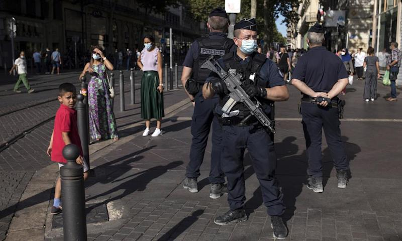 Police officers on patrol in Marseille, where face masks are compulsory in public spaces.