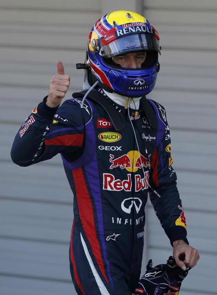 Red Bull Formula One driver Mark Webber of Australia celebrates taking pole position after the qualifying session of the Japanese F1 Grand Prix at the Suzuka circuit October 12, 2013. REUTERS/Issei Kato (JAPAN - Tags: SPORT MOTORSPORT F1)