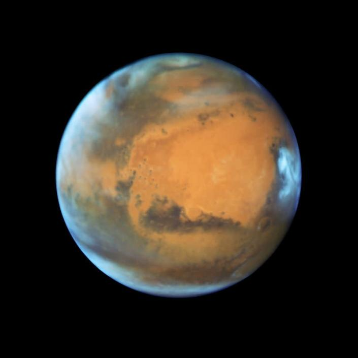 FILE PHOTO: The planet Mars taken by the NASA Hubble Space Telescope when the planet was 50 million miles from Earth