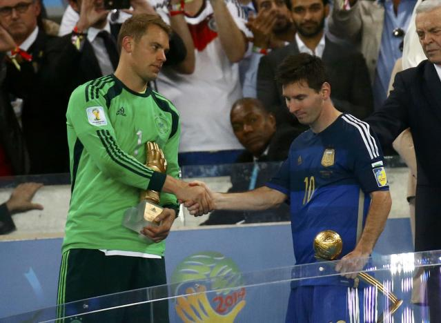 Golden Glove winner Germany's goalkeeper Manuel Neuer (L) congratulates Golden Ball winner Argentina's Lionel Messi (10) after their 2014 World Cup final at the Maracana stadium in Rio de Janeiro July 13, 2014. REUTERS/Kai Pfaffenbach (BRAZIL - Tags: SOCCER SPORT WORLD CUP)
