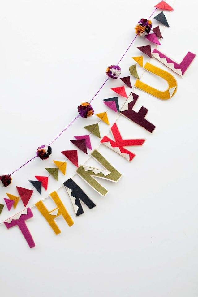 """<p>It's so pretty, you'll want to leave it up all year. Spoiler: Glue gun skills are required. Get the tutorial at <a href=""""https://tellloveandparty.com/2014/11/tell-thanksgiving-banner.html"""" target=""""_blank"""">Tell, Love, and Party</a>. </p><p><a class=""""body-btn-link"""" href=""""https://www.amazon.com/HEART-Super-Saver-Cherry-Red/dp/B0017342OY/ref=sr_1_1?tag=syn-yahoo-20&ascsubtag=%5Bartid%7C10057.g.22626327%5Bsrc%7Cyahoo-us"""" target=""""_blank"""">BUY NOW</a> <strong><em>Red Yarn, $4</em></strong></p>"""