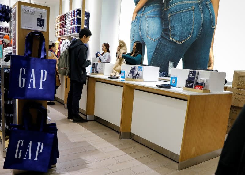 FILE PHOTO: Holiday shoppers take part in early Black Friday shopping deals at the Gap store on the Thanksgiving holiday in Times Square in New York
