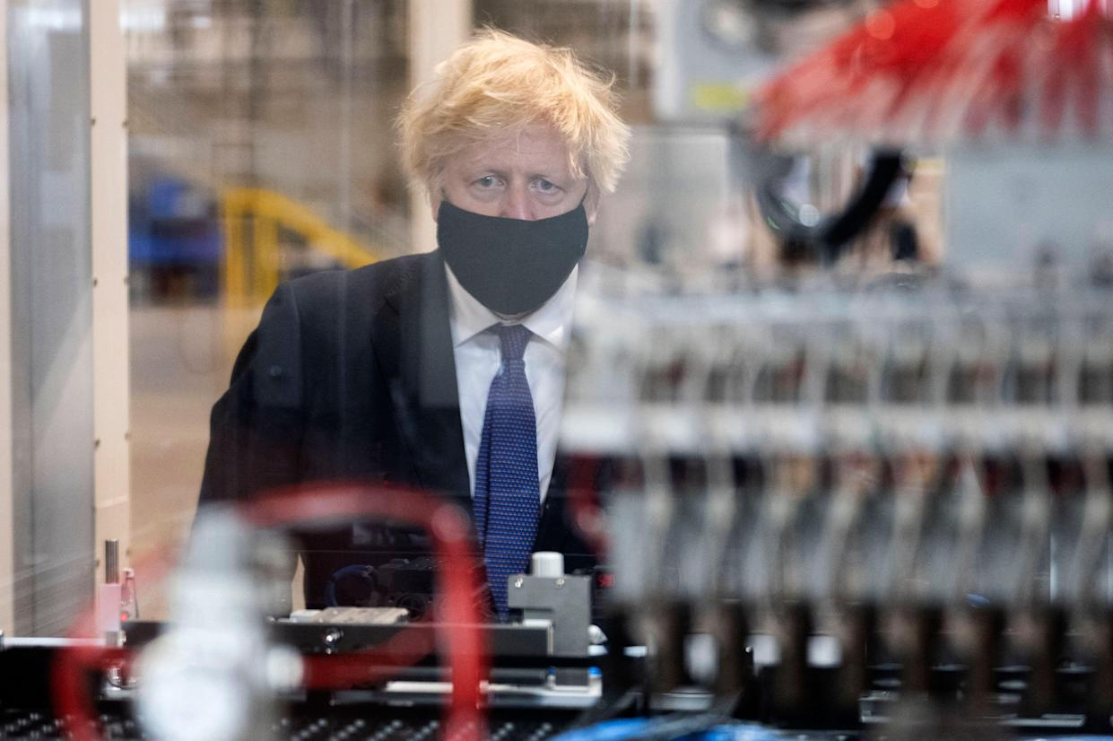 Britain's Prime Minister Boris Johnson gestures during a visit to the UK Battery Industrialisation Centre in Coventry, central England on July 15, 2021.       West Midlands. 15th July 2021 (Photo by David Rose / POOL / AFP) (Photo by DAVID ROSE/POOL/AFP via Getty Images)