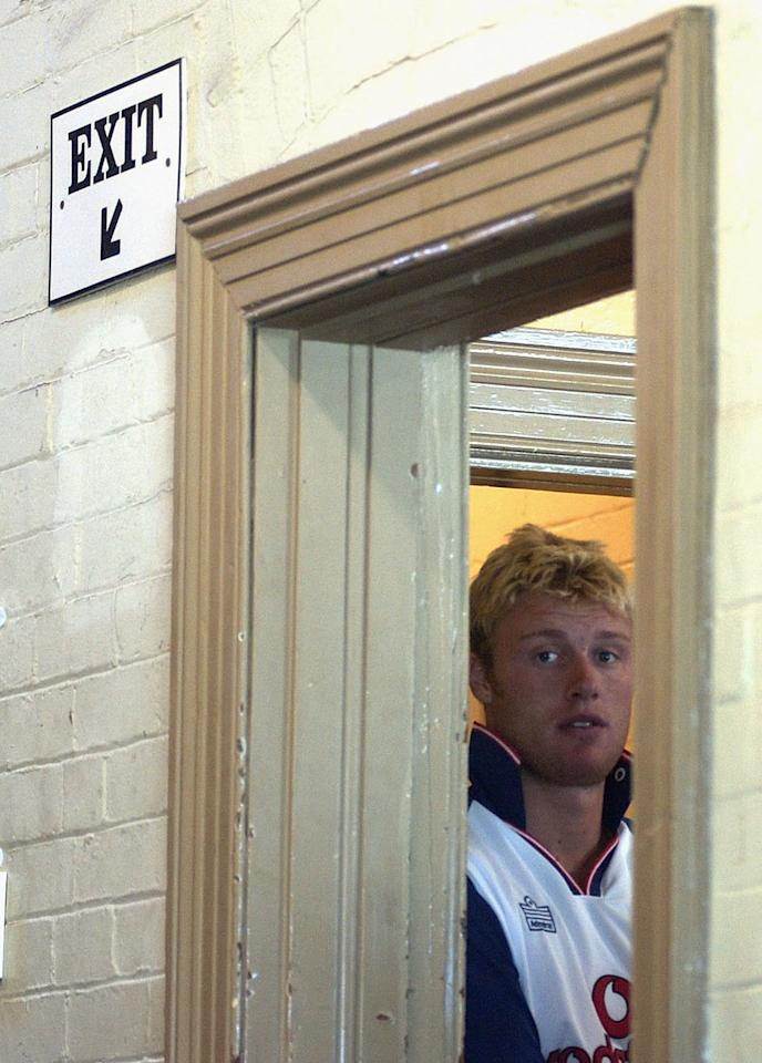 SYDNEY - DECEMBER 12:  Andrew Flintoff of England looks on from the dressing room during an England cricket team training session at the Sydney Cricket Ground in Sydney, Australia on December 12, 2002. (Photo by Tom Shaw/Getty Images)