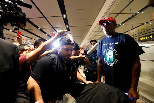 Former basketball player Dennis Rodman arrives at Changi Airport in Singapore, June 12, 2018. REUTERS/Feline Lim