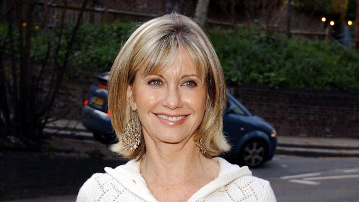 Olivia Newton-John claims she's visited by the ghosts of her famous friends