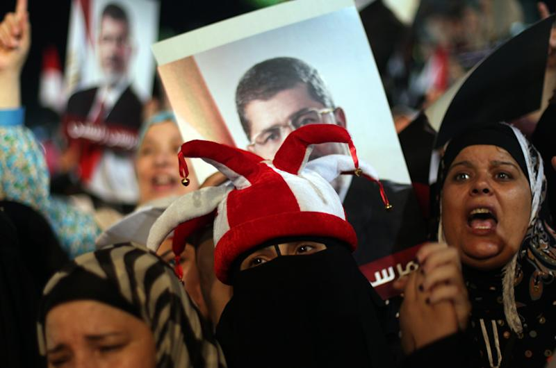 Supporters of Egypt's ousted President Mohammed Morsi chant slogans during a protest at Nasr City, where protesters have installed their camp and hold their daily rally, in Cairo, Egypt, Friday, July 26, 2013. Prosecutors opened an investigation of ousted President Mohammed Morsi on charges including murder and conspiracy with the Palestinian militant group Hamas, fueling tensions amid a showdown in the streets between tens of thousands of backers of the military and supporters calling for the Islamist leader's reinstatement. (AP Photo/Khalil Hamra)