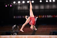 <p>USA's Jade Carey competes in the artistic gymnastics balance beam event of the women's qualification during the Tokyo 2020 Olympic Games at the Ariake Gymnastics Centre in Tokyo on July 25, 2021. (Photo by Loic VENANCE / AFP) (Photo by LOIC VENANCE/AFP via Getty Images)</p>