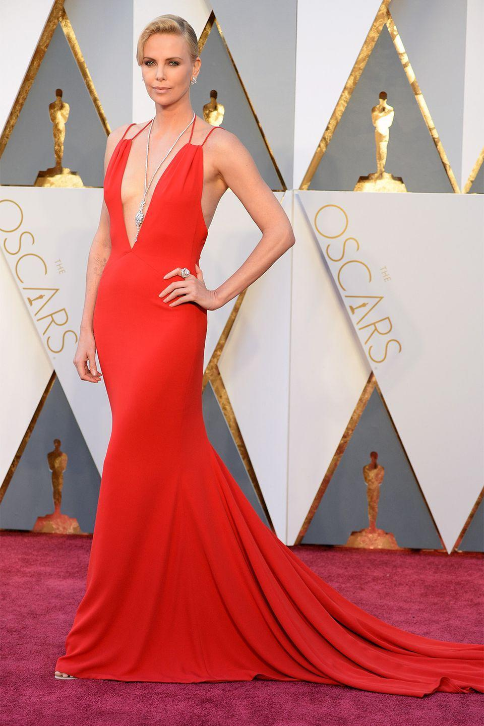 <p>Charlize Theron and Dior go hand-in-hand, the seasoned actress has worked with the French house for years, appearing in their J'adore Dior fragrance ad. This red number was simple yet left a mark on the red carpet. </p>