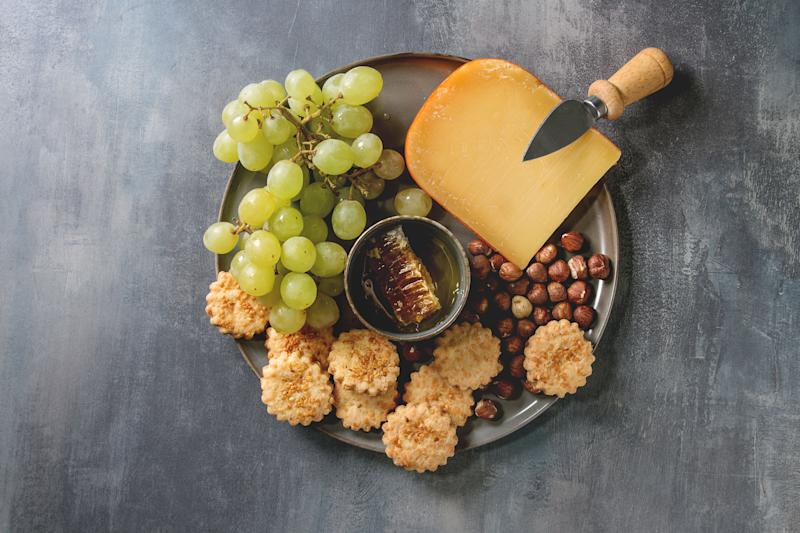 """Snacks aren't meals, but as <a href=""""https://chronicillnessbloggers.com/2019/06/19/foodprepideas/"""" target=""""_blank"""" rel=""""noopener noreferrer"""">Chronic Illness Bloggers</a> recommends, they're perfect on days when parents have absolutely no energy to cook or prep. A kid-friendly charcuterie board can be a life-saver in this regard. Most children will happily eat crackers and mellow cheeses like cheddar. &nbsp;You can supplement with fruits like grapes, cold cuts, and nuts from your pantry.&nbsp;"""