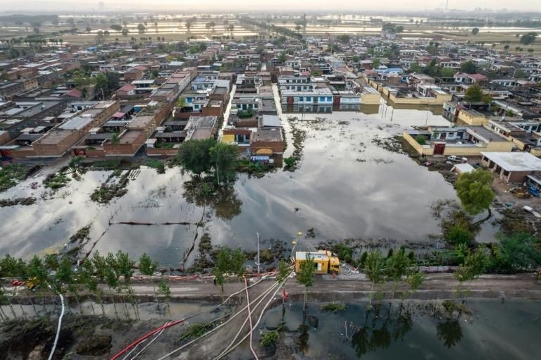 More than 1.75 million residents have so far been affected by the floods in Shanxi (AFP/STR)
