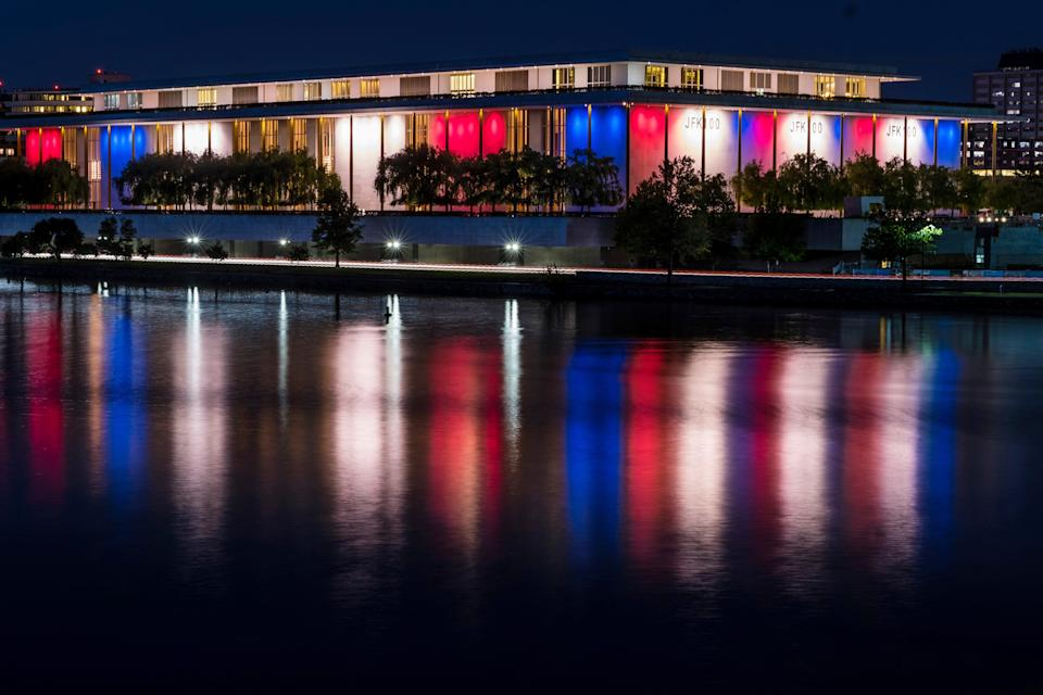 Red, white and blue lights mark the 100th birthday of President John F. Kennedy outside the Kennedy Center for the Performing Arts in Washington on May 26, 2017.