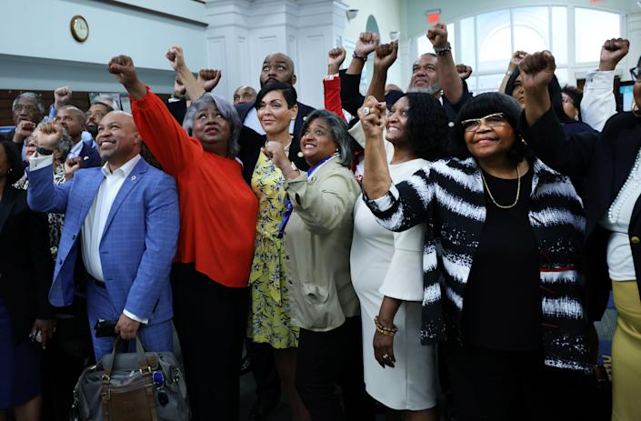 Members of the Texas Legislative Black Caucus pose for a photo as they visit the Kate Waller Barrett Branch Library, on 16 July 2021 in Alexandria, Virginia (Getty Images)