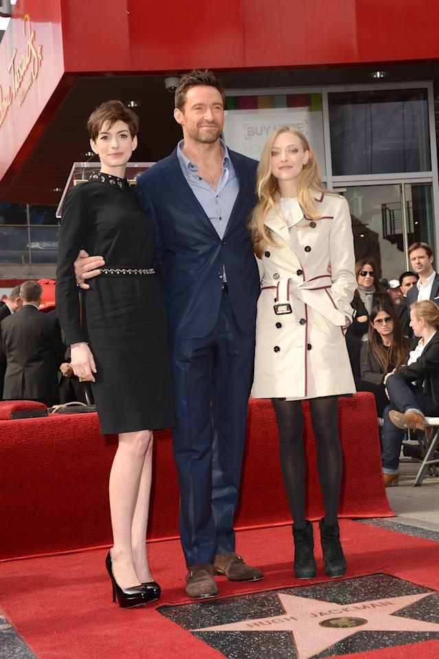 HOLLYWOOD, CA - DECEMBER 13:  Actors Anne Hathaway, Hugh Jackman, and Amanda Seyfried attend the Hugh Jackman Hollywood Walk Of Fame ceremony on December 13, 2012 in Hollywood, California.  (Photo by Jason Merritt/Getty Images)