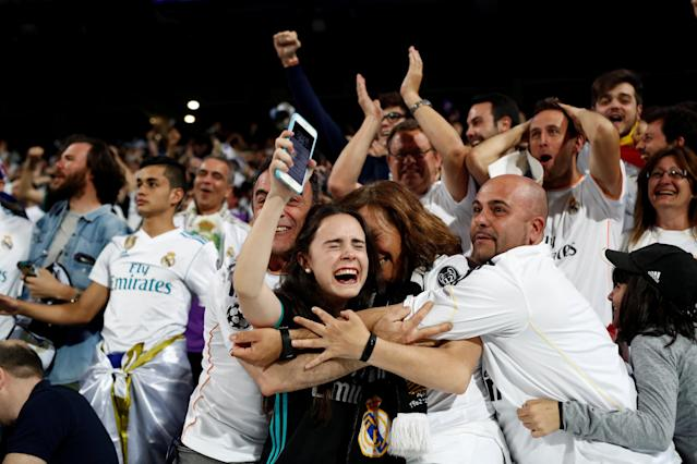 Soccer Football - Real Madrid fans watch the Champions League Final - Madrid, Spain - May 26, 2018 Real Madrid fans celebrate their second goal while inside the Santiago Bernabeu REUTERS/Javier Barbancho TPX IMAGES OF THE DAY