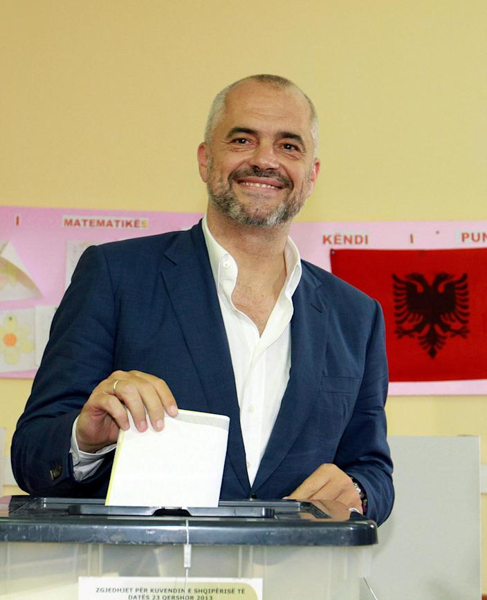 Main opposition Socialist Party leader Edi Rama poses for photographers before he casts his ballot during elections in Tirana, Albania, Sunday, June 23, 2013. Socialist leader Edi Rama and his close rival Prime Minister Sali Berisha of the Democratic Party have hopes for eventual entry to the European Union, but the bloc has expressed concern over whether the country can manage to run fair and free elections. (AP Photo/Hektor Pustina)