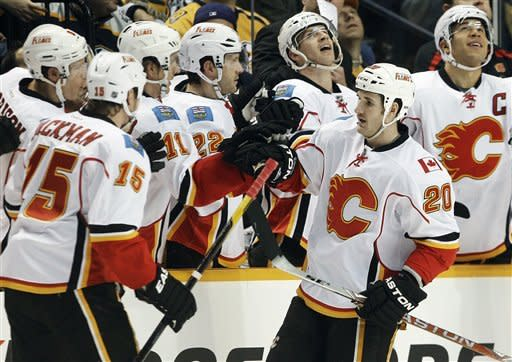 Calgary Flames left wing Curtis Glencross (20) is congratulated after scoring against the Nashville Predators in the second period of an NHL hockey game on Tuesday, Dec. 13, 2011, in Nashville, Tenn. (AP Photo/Mark Humphrey)