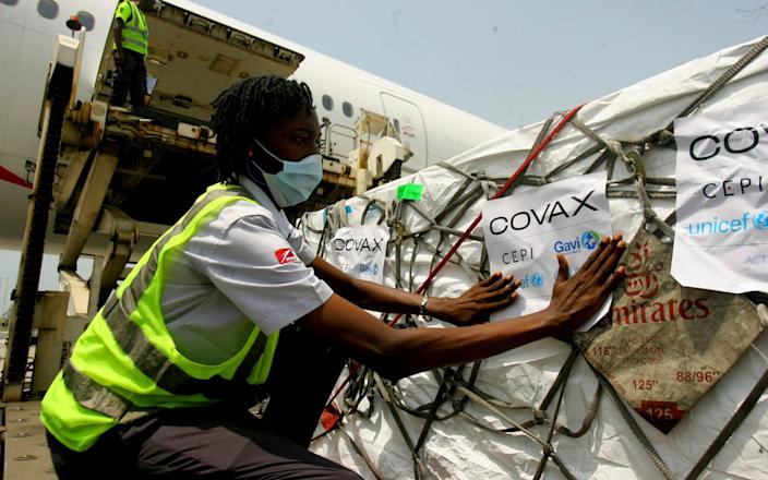 A shipment of COVID-19 vaccines distributed by the COVAX Facility arrives in Abidjan, Ivory Coast, Friday Feb. 25 - Diomande Ble Blonde / AP