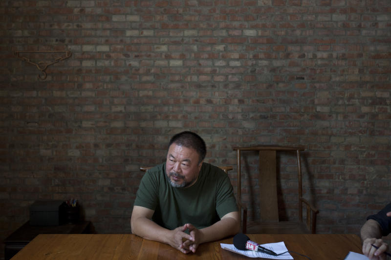 "Artist Ai Weiwei speaks to journalists at his studio in Beijing, China, Wednesday, May 22, 2013. Ai's music video accompanying his heavy metal single ""Dumbass'' released Wednesday depicts an insensitive, overbearing state power that tramples on individual rights. The video is meant to reconstruct his 81-day secret detention in 2011, which was part of the overall crackdown by Chinese authorities on dissent. Ai later was convicted of tax evasion, which his supporters saw as punishment for his activism.(AP Photo/Alexander F. Yuan)"
