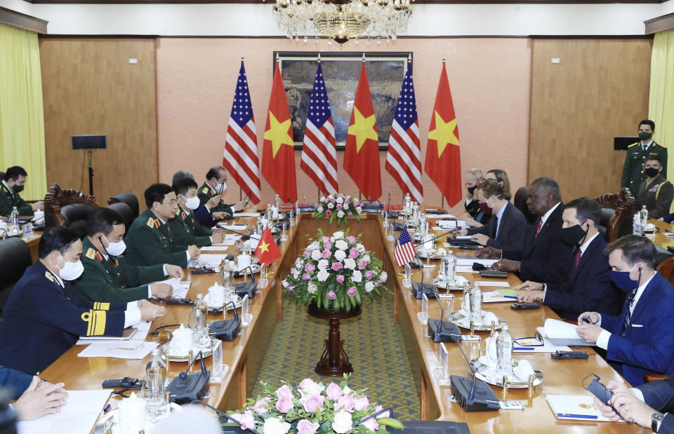 U.S Defense Secretary Lloyd Austin, third from right, and Vietnamese Defense Minister Phan Van Giang, third from left, hold a meeting in Hanoi, Vietnam, Thursday, July 29, 2021. Austin is seeking to bolster ties with Vietnam, one of the Southeast Asian nations embroiled in a territorial rift with China, during a two-day visit. (Nguyen Trong Duc/VNA via AP)