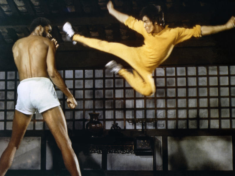 American actor Kareem Abdul-Jabbar and Chinese American martial artist and actor Bruce Lee on the set of Game of Death, written and directed by Robert Clouse. (Photo by Concord Productions Inc./Golden Harvest Company/Sunset Boulevard/Corbis via Getty Images)