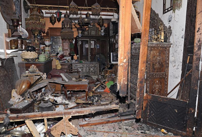 This photo released by the Syrian official news agency SANA, shows a damaged antique shop that was destroyed by a blast struck in the vicinity of the Greek Orthodox Virgin Mary Church in the predominantly Christian neighborhood of Bab Sharqi in central Damascus, Syria, Thursday, June 27, 2013. A suicide attacker blew himself up near one of the main churches in the Syrian capital Thursday, killing several people, state-run TV said. (AP Photo/SANA)