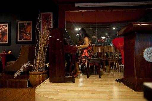 A woman is seen playing a piano at a singles club in Beijing. A 2010 survey showed that there were 180 million single men and women in China -- out of a population of 1.3 billion people -- and that 92 percent of men questioned believed that a woman should be married before the age of 27