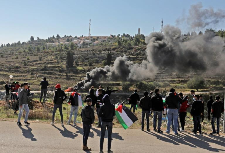 Palestinians demonstrate near the Israeli settlement of Psagot, built on the lands of the city of al-Bireh, against the visit by Pompeo to the settlement in the occupied West Bank