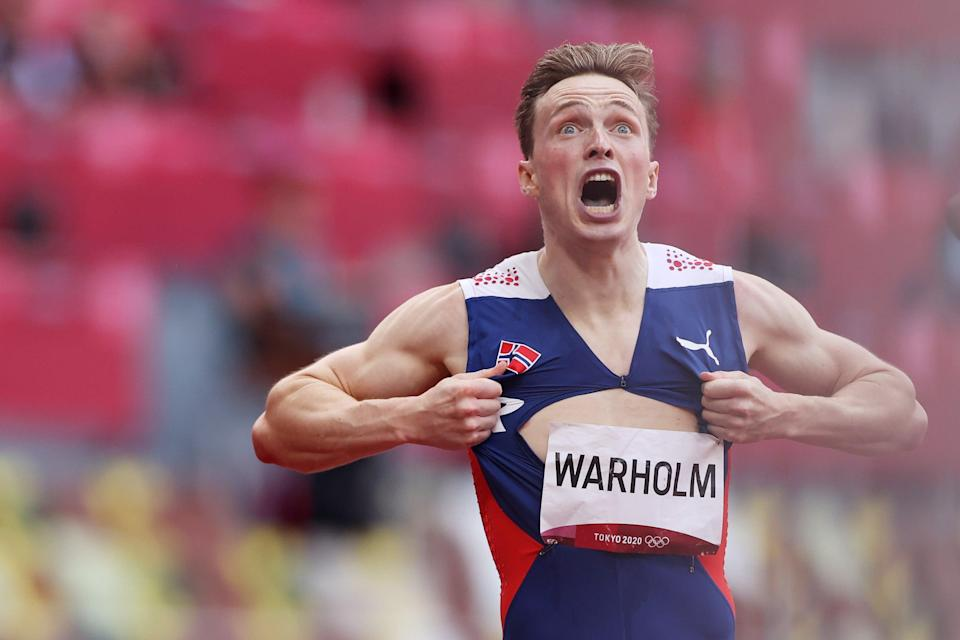 Warholm rips open his shirt after wining gold (Getty Images)