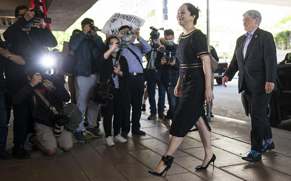 Meng Wanzhou walks past the media upon arriving at BC Supreme Court for her hearing on May 27, 2020 in Vancouver - Rich Lam/Getty Images