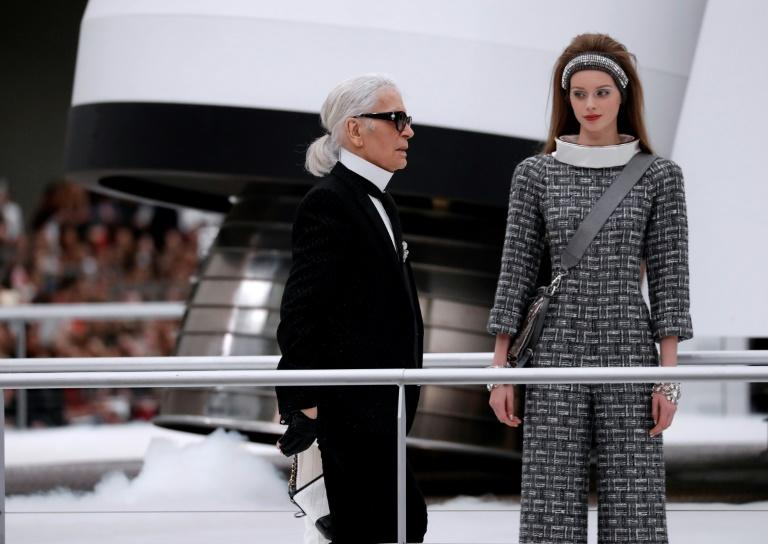 German fashion designer Karl Lagerfeld acknowledges the audience during the Chanel show