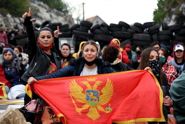 Some of the protestors had stayed out overnight at the barricades set up on Saturday (AFP/SAVO PRELEVIC)