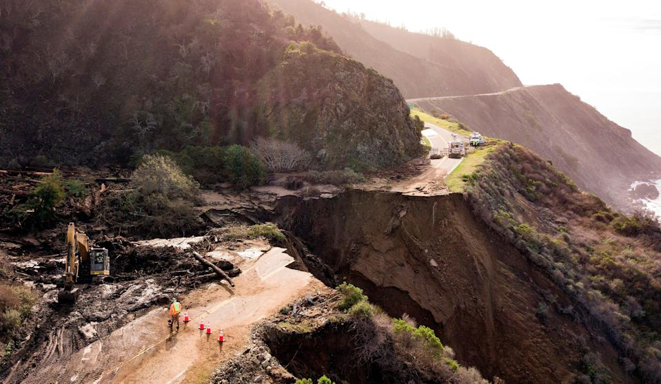 <p>Construction crews work on a section of Highway 1, which collapsed into the Pacific Ocean near Big Sur, California on January 31, 2021. Heavy rains caused debris flows of trees, boulders and mud that washed out a 150-foot section of the road. </p> ((Photo by JOSH EDELSON / AFP) )
