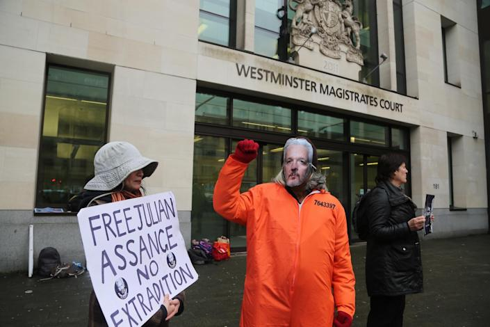A demonstrator wearing a Julian Assange mask in London. (Ilyas Tayfun Salci/Anadolu Agency via Getty Images)