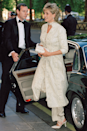 <p>Princess Diana stunned in a white shalwar kameez and matching heels for a formal dinner at London's Dorchester Hotel in July 1996.</p>