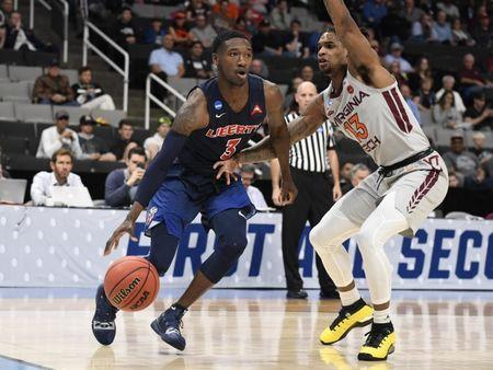 Mar 24, 2019; San Jose, CA, USA; Liberty Flames guard Lovell Cabbil Jr. (3) drives to the basket against Virginia Tech Hokies guard Ahmed Hill (13) during the first half in the second round of the 2019 NCAA Tournament at SAP Center. Mandatory Credit: Kelley L Cox-USA TODAY Sports