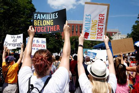 FILE PHOTO: Immigration activists hold signs against family separation during a rally to protest against the Trump Administration's immigration policy outside the White House in Washington, U.S., June 30, 2018. REUTERS/Joshua Roberts/File Photo