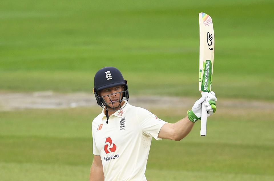 Jos Buttler of England celebrates his half century during Day One of the Third Test.