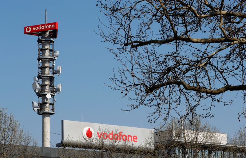 Different types of 4G, 5G and data radio relay antennas for mobile phone networks are pictured on a relay mast operated by Vodafone in Berlin