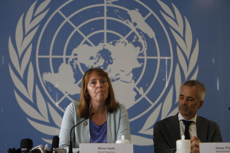 UN Special Rapporteur on the Situation of Human Rights in Cambodia Rhona Smith, left, answers questions with her colleague Simon Walker during a press conference in Phnom Penh, Cambodia, Thursday, Nov. 8, 2018. (AP Photo/Heng Sinith)