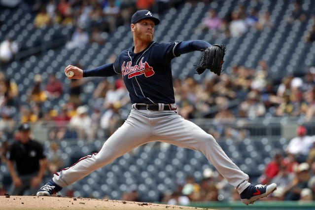 Atlanta Braves starting pitcher Mike Foltynewicz delivers during the first inning of the team's baseball game against the Pittsburgh Pirates in Pittsburgh, Thursday, June 6, 2019. (AP Photo/Gene J. Puskar)