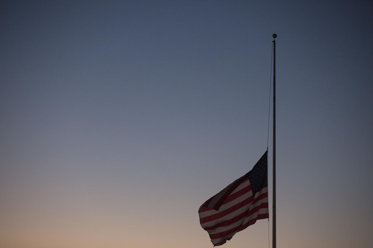 <p>A flag in Draffenville, Ky., less than a mile from Marshall County High School where a 15-year-old student opened fire on fellow students, flies at half-staff at dawn on Thursday, Jan. 25, 2018. (Photo: Ryan Hermens/The Paducah Sun via AP) </p>
