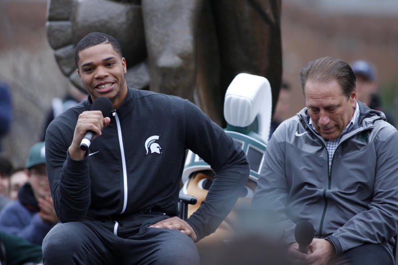 Michigan State's Miles Bridges, left, speaks as men's basketball coach Tom Izzo, right, listens during an NCAA college basketball news conference, Thursday, April 13, 2017, in East Lansing, Mich. Bridges, a 6-foot-7 forward from Flint, Mich., announced he is returning for his sophomore season. (AP Photo/Al Goldis)
