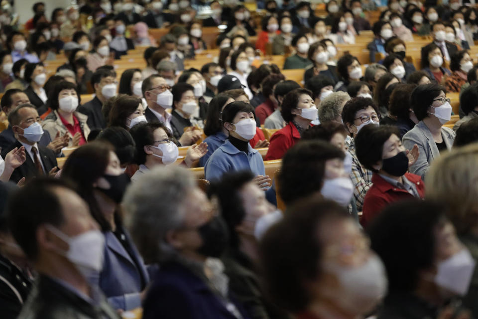Christians wearing face masks attend a service at the Yoido Full Gospel Church in Seoul, South Korea, Sunday, May 10, 2020. South Korea's President Moon Jae-in urged citizens not to lower their guard down, but said there's no reason to be panicked amid worries about a new surge in the coronavirus outbreak in the country.(AP Photo/Ahn Young-joon)