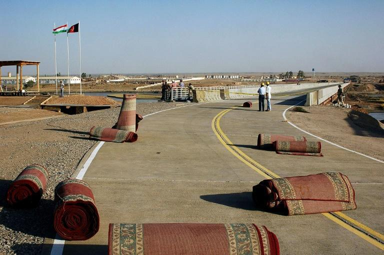 The crossing is marked by a 700-metre US-funded bridge that opened in 2007 with the aim of boosting trade between the central Asian neighbours