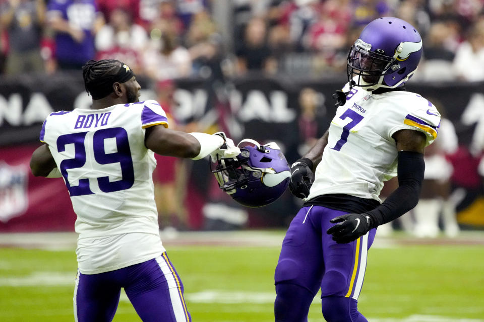Minnesota Vikings cornerback Patrick Peterson (7) celebrates a defensive stop with defensive back Kris Boyd (29) during the first half of an NFL football game against the Arizona Cardinals, Sunday, Sept. 19, 2021, in Glendale, Ariz. (AP Photo/Rick Scuteri)