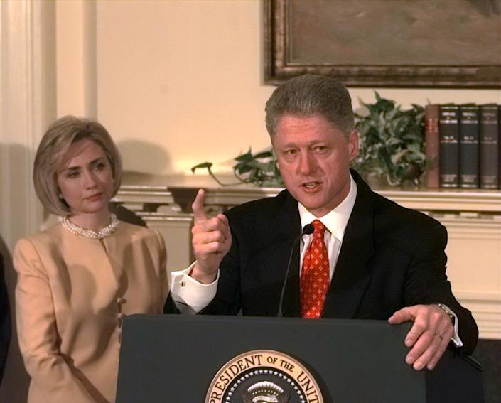 President Bill Clinton denies improper behavior with White House intern Monica Lewinsky as first lady Hillary Clinton looks on, January 1998. (Photo: Harry Hamburg/N.Y. Daily News via Getty Images)