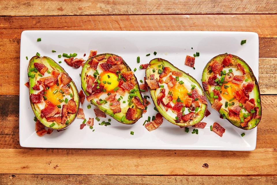 """<p>The monosaturated fats in avocados contribute to healthy blood flow to all your limbs, which will help if you're feeling sluggish after rolling out of bed.</p><p>Get the recipe from <a href=""""https://www.delish.com/cooking/recipe-ideas/recipes/a45382/avocado-egg-boats-recipe/"""" rel=""""nofollow noopener"""" target=""""_blank"""" data-ylk=""""slk:Delish"""" class=""""link rapid-noclick-resp"""">Delish</a>.<br></p>"""